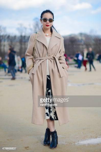 Yu Lee wears a Ter et Bantine coat American Vintage jumper HM skirt Kurt Geiger shoes and Spectre sunglasses after Valentino show a the Jardins des...