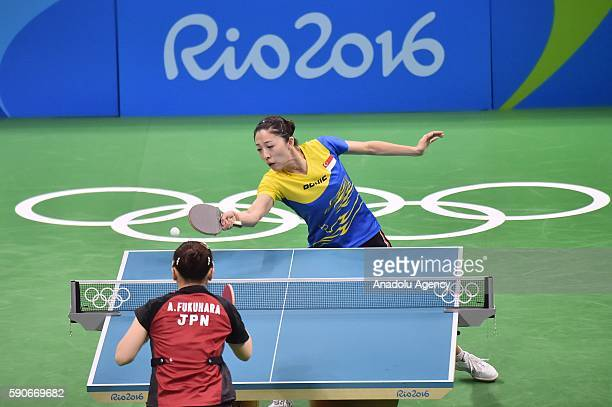 Yu Mengyu of Singapore competes against Fukuhara Ai of Japan in the Womens Team Bronze Medal Team Match on Day 11 of the 2016 Rio Olympics at...
