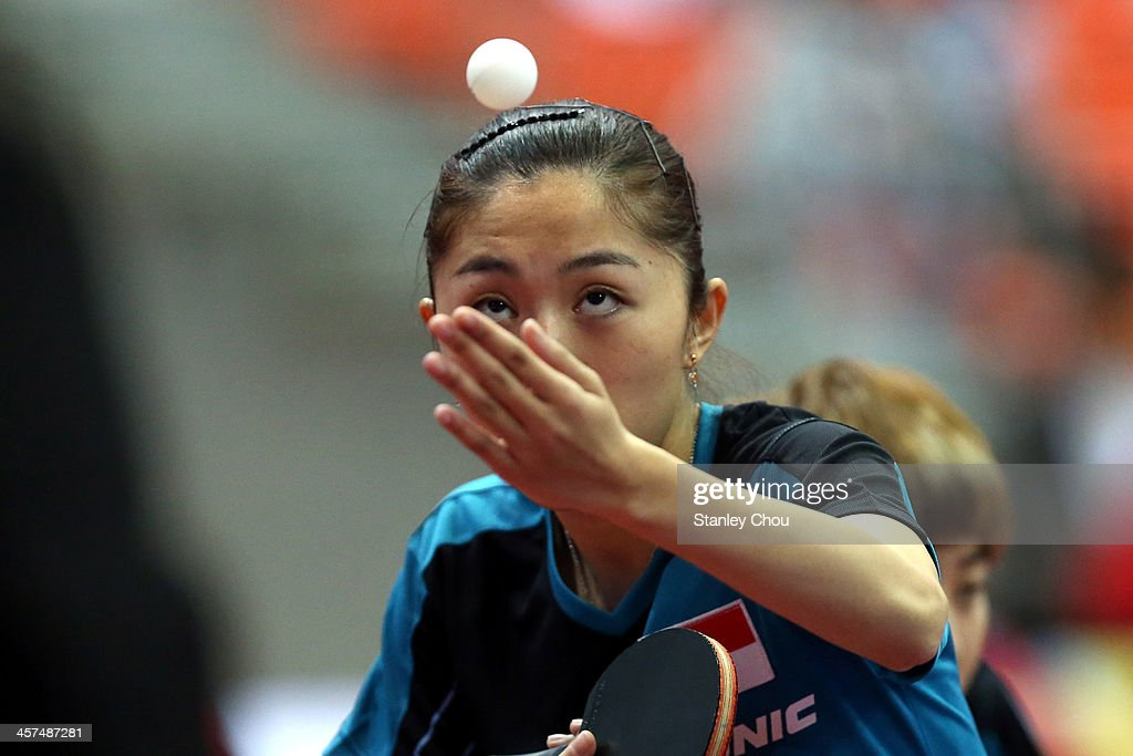 Yu Mengyu of Singapore in action during the Women's Doubles Table Tennis Team Competition during the 2013 SEA Games at the Wunna Theikdi Indoor Stadium on December 18, 2013 in Nay Pyi Taw, Burma.