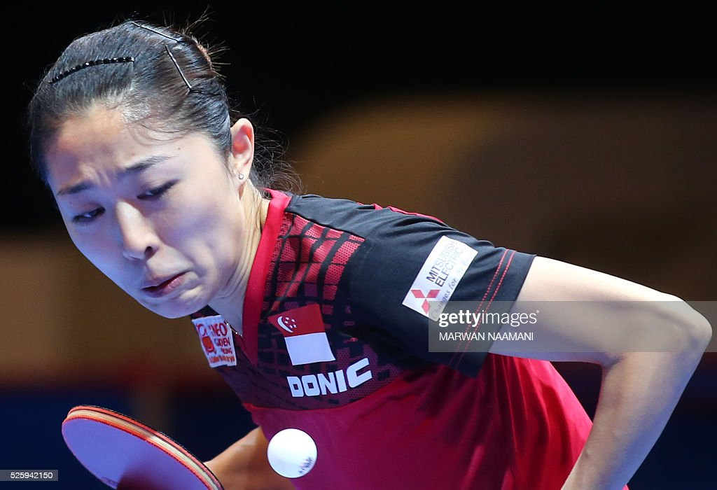 Yu Mengyu of Singapore serves the ball to Tie Yana of Hong Kong during their women's singles quarter final table tennis match in the ITTF Nakheel Table Tennis Asian Cup, in Dubai, on April 29, 2016. / AFP / MARWAN