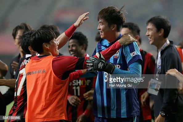 Yu SangHun of FC Seoul celebrates with team mates after winning the penalty shootout during the AFC Champions League Round Of 16 match between FC...