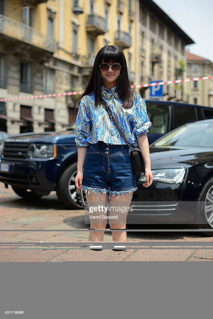 Yu Tong is seen wearing a Kenzo shirt, vintage shorts, Chanel bag and Nike trainers after Gucci show on June 23, 2014 in Milan, Italy.