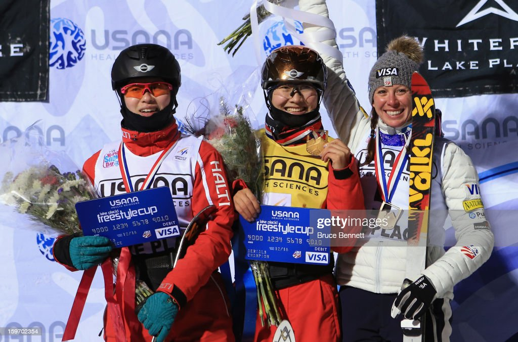 Yu Yang (second place) and Mentao Yu (first place), both of China and Emily Cook (third place) of the USA pose with their medals following the USANA Freestyle World Cup aerial competition at the Lake Placid Olympic Jumping Complex on January 18, 2013 in Lake Placid, New York.