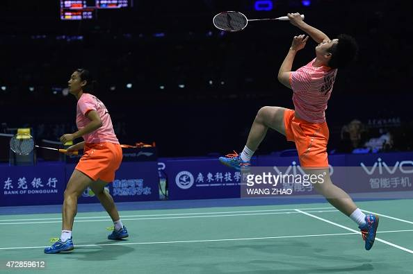 Yu Yang and Tang Yuanting of China return to Birgit Michels and Isabel Herttrich of Germany during their women's doubles match of the 2015 Sudirman...