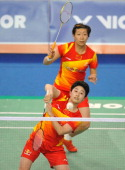 Yu Yang and Wang Xiaoli of China play a shot in their women's doubles badminton match against Ma Jin and Tang Jinhua of China during the finals of...