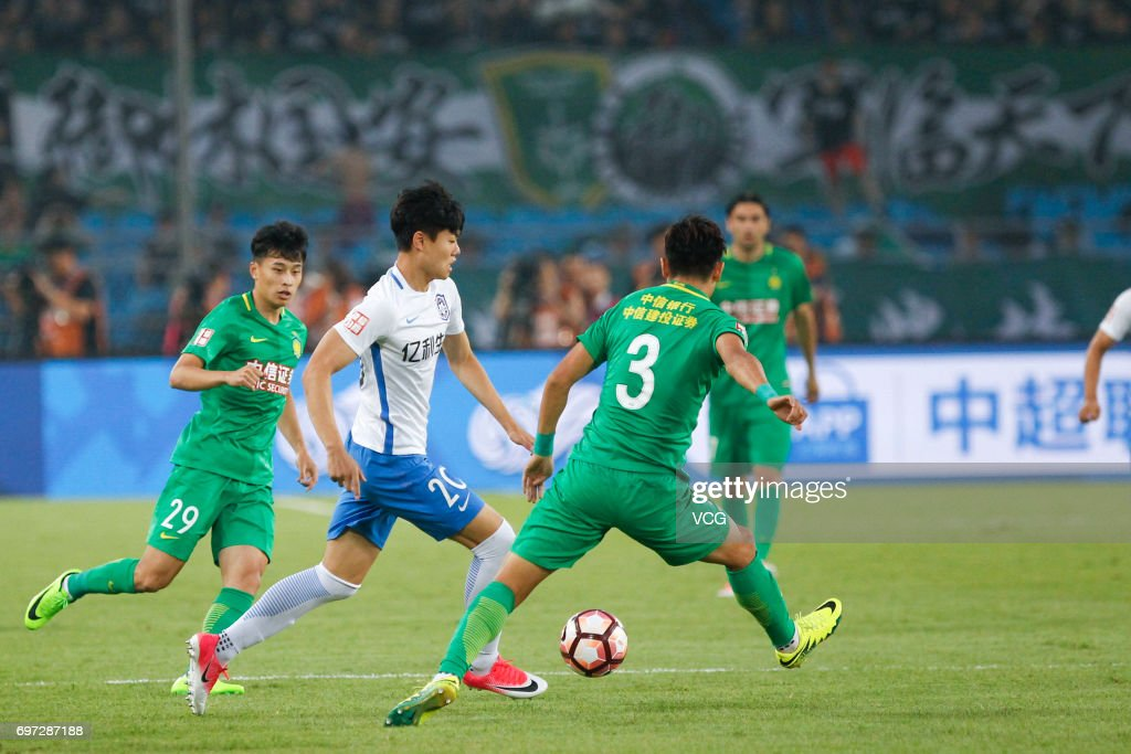 Yu Yang #3 of Beijing Guoan and Yang Liyu # 20 of Tianjin Teda compete for the ball during the 13th round match of 2017 Chinese Football Association Super League (CSL) between Beijing Guoan and Tianjin Teda at Beijing Workers' Stadium on June 18, 2017 in Beijing, China.