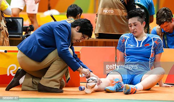 Yu Yang of China sits on ground during the Badminton Women's Doubles Quarterfinal match with Tang Yuanting of China against Nitya Krishinda Maheswari...