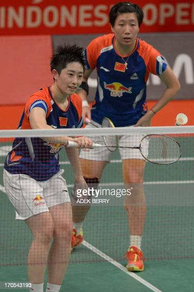 Yu Yang plays a return as Wang Xiaoli of China looks as they play against Anneke Feinya Agustin and Della Destiara Haris of Indonesia during their...