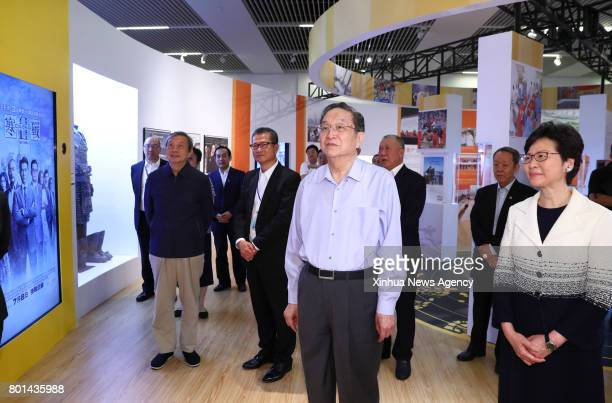 Yu Zhengsheng chairman of the National Committee of the Chinese People's Political Consultative Conference visits an exhibition profiling the...