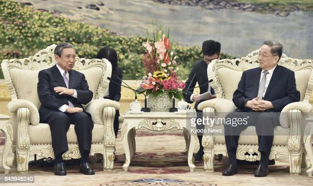 Yu Zhengsheng China's fourthhighest ranking leader meets with former Japanese lower house speaker Yohei Kono in Beijing's Great Hall of the People on...