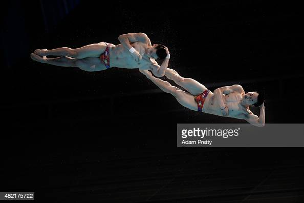Yuan Cao and Kai Qin of China compete in the Men's 3m Springboard Synchronised Diving Preliminary on day four of the 16th FINA World Championships at...