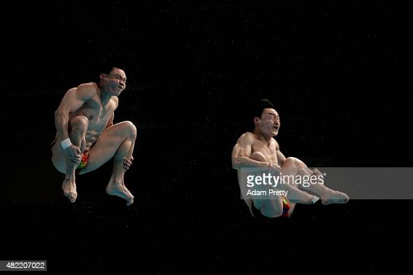 Yuan Cao and Kai Qin of China compete in the Men's 3m Springboard Synchronised Diving Final on day four of the 16th FINA World Championships at the...