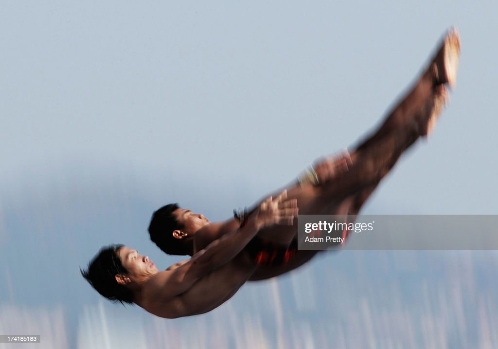 Yuan Cao and Yanguan Zhang of China compete in the Men's 10m Platform Synchronised Diving preliminary round on day two of the 15th FINA World Championships at Piscina Municipal de Montjuic on July 21, 2013 in Barcelona, Spain.