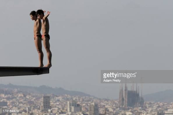 Yuan Cao and Yanquan Zhang of China compete in the Men's 10m Platform Synchronised Diving final on day two of the 15th FINA World Championships at...