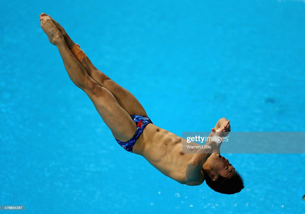 Yuan Cao of China dives in the Men's 3m Springboard semi final during day two of the FINA/NVA Diving World Series 2014 at the Hamdan Sports Complex on March 21, 2014 in Dubai, United Arab Emirates.