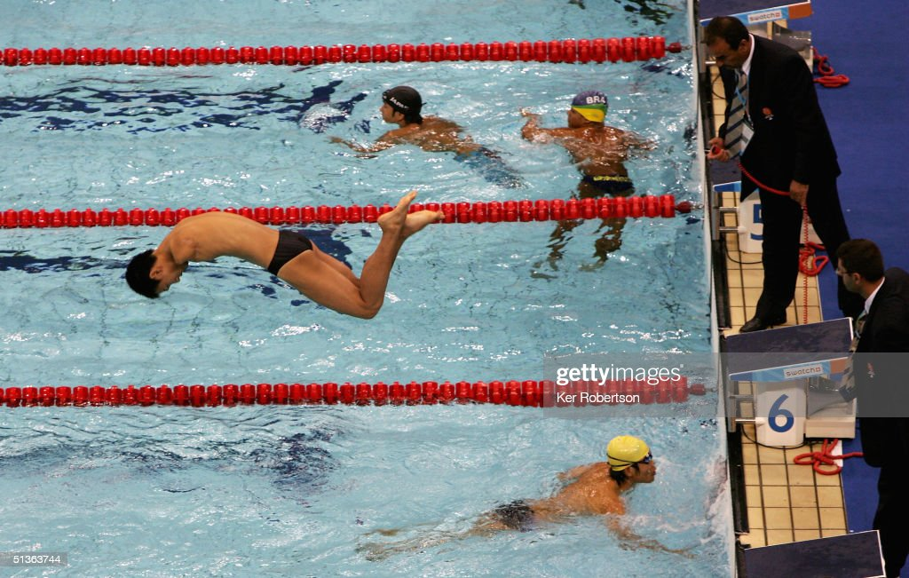 Yuan Tang of China dives into the pool during the Mens 4 x 50m Medley 20 Pts Final during the Athens 2004 Paralympic Games September 27 2004 at the...