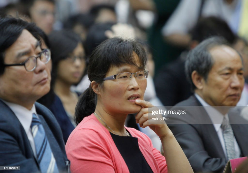 Yuan Weijing wife of Chinese lawyer and human rights activist Chen Guangcheng listens to at Chen's speech at the Legislative Yuan on June 25 2013 in...