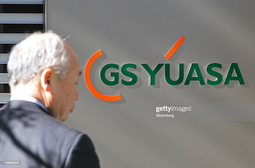 GS Yuasa Corp.'s logo is displayed outside the company's office in Tokyo, Japan, on Friday, Jan. 18, 2013. A unit of Kyoto, Japan-based GS Yuasa Corp., whose batteries are now under investigation after incidents that led to the worldwide grounding of Boeing's 787 Dreamliner fleet, won a contract in August to supply lithium-ion battery cells to help power the International Space Station. Photographer: Junko Kimura/Bloomberg via Getty Images