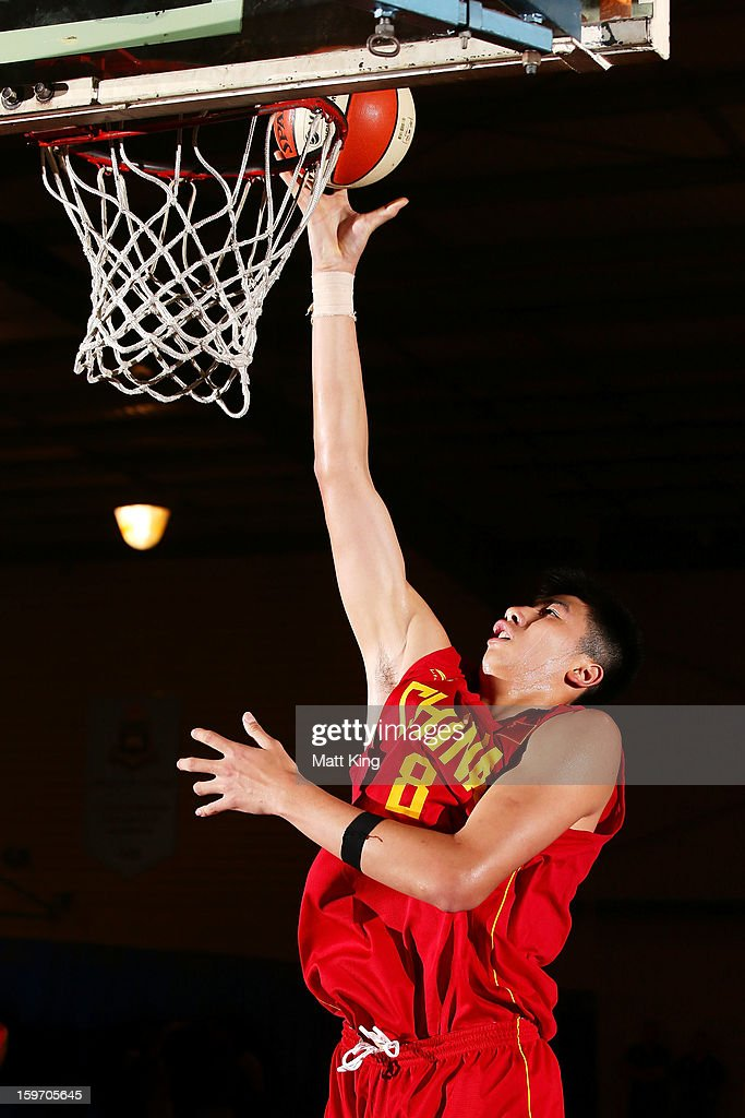 Yuchen Zou of China drives to the basket in the bronze medal playoff game against Great Britain during day four of the Australian Youth Olympic Festival at Sydney Boys High School on January 19, 2013 in Sydney, Australia.