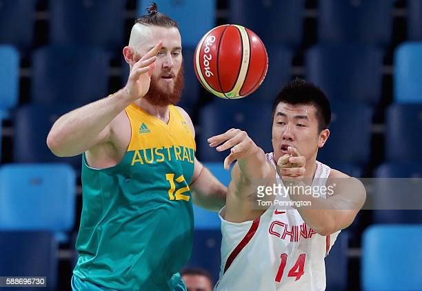 Yuchen Zou of China passes the ball against Aron Baynes of Australia during the Men's Basketball Preliminary Round Group A China vs Australia on Day...