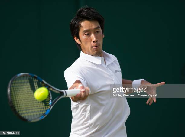 Yuchi Sugita of Japan in action during his victory over Brydan Klein of Great Britain in their Men's Singles First Round Match at Wimbledon on July 4...
