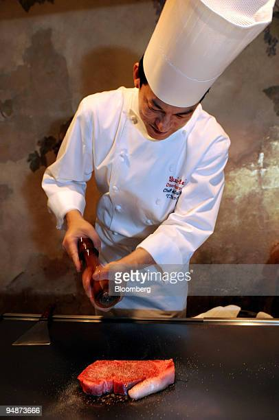 Yudai Hanno head chef at Omotesando Ukaitei teppanyaki restaurant seasons steak that he cooks on a teppanyaki griddle at the restaurant in the...