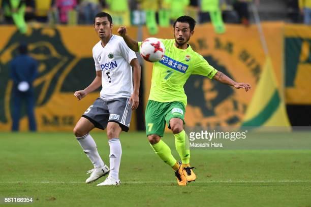 Yudai Iwama of Matsumoto Yamaga and Yuto Sato of JEF United Chiba compete for the ball during the JLeague J2 match between JEF United Chiba and...