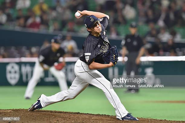Yudai Ohno of Japan pitches in the bottom half of the sixth inning during the sendoff friendly match for WBSC Premier 12 between Japan and Puerto...