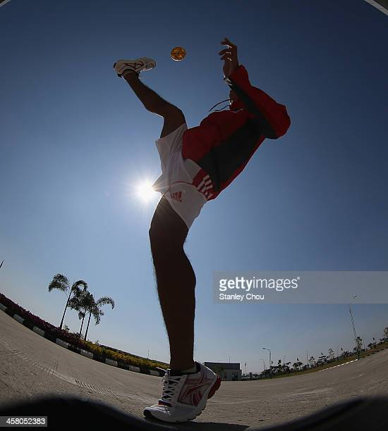 Yudi Pornomo of Indonesia warms up prior to the start of the Men's Team Double Final of the Sepak Takraw Competition between Indonesia and Burma...