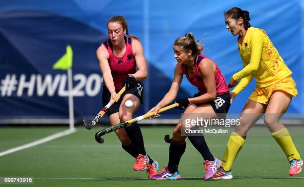 Yudiao Zhao of China battles with Alison Howie and Robyn Collins of Scotland during the FINTRO Women's Hockey World League SemiFinal Pool A game...