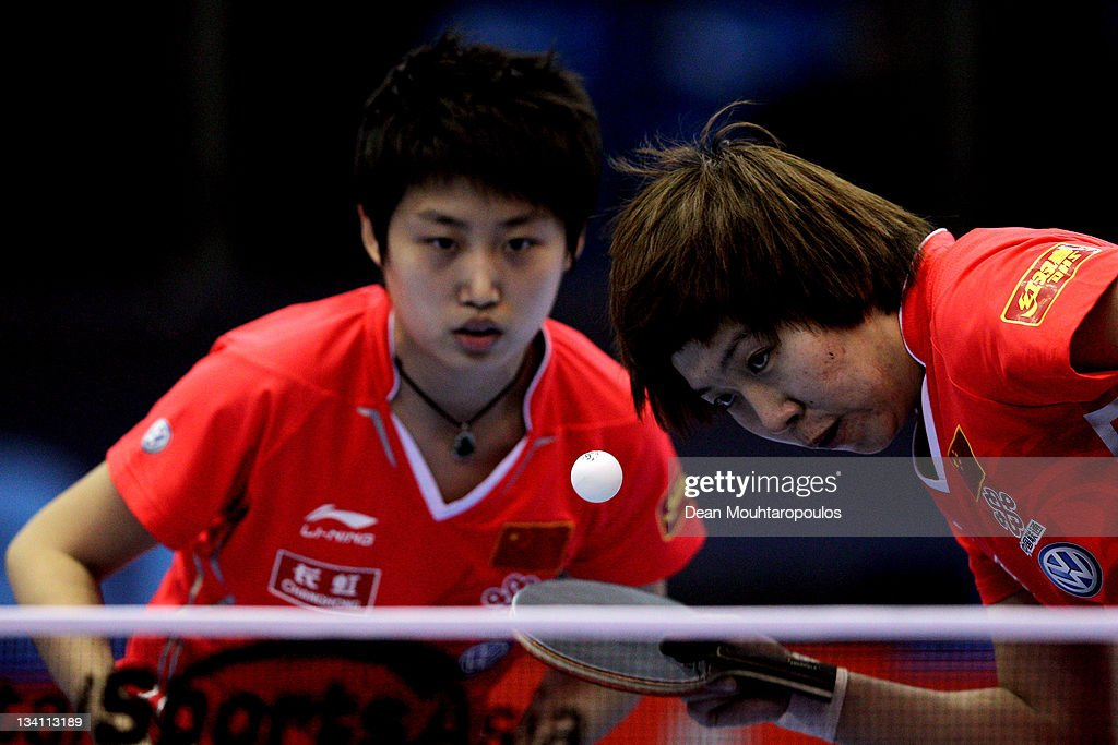 Yue Guo (L) and <a gi-track='captionPersonalityLinkClicked' href=/galleries/search?phrase=Xiaoxia+Li&family=editorial&specificpeople=4049514 ng-click='$event.stopPropagation()'>Xiaoxia Li</a> of China compete against Huajun Jiang and Yana Tie of Hong Kong during the Womens Doubles Quarter Finals match during day three of the ITTF Pro Tour Table Tennis Grand Finals at ExCel on November 26, 2011 in London, England.