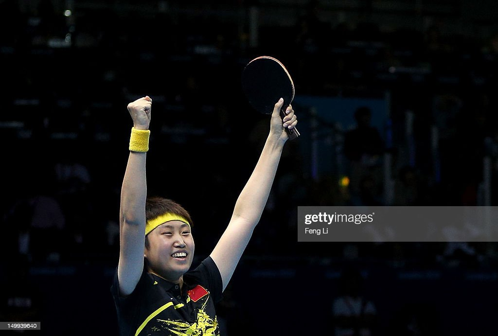 Yue Guo of China celebrates their 3-1 victory against Kasumi Ishikawa and Sayaka Hirano of Japan and winning the Women's Team Table Tennis gold medal match on Day 11 of the London 2012 Olympic Games at ExCeL on August 7, 2012 in London, England.