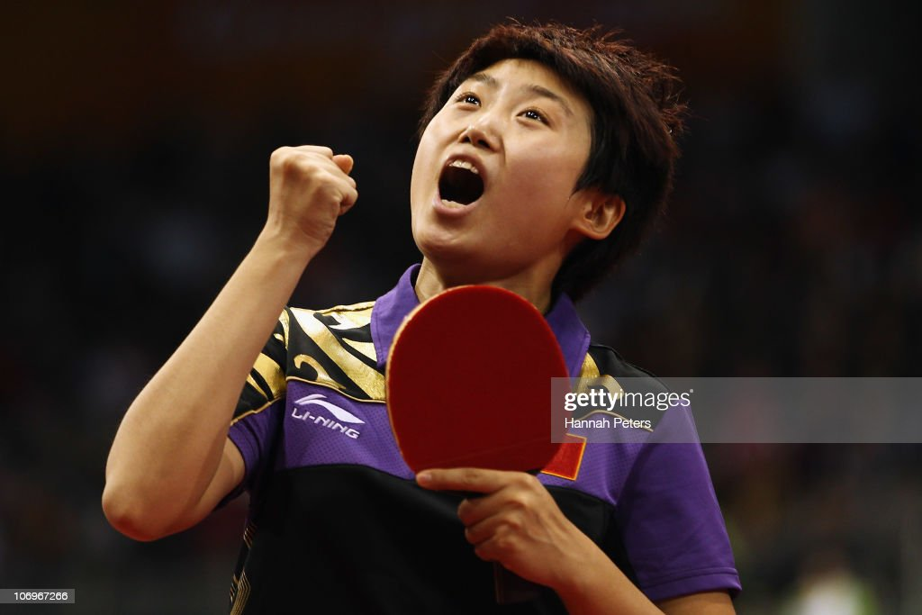 Yue Guo of China celebrates winning the Women's Doubles Final with Xiaoxia Li of China against Ning Ding and Shiwen Liu of China at Guangzhou Gymnasium during day seven of the 16th Asian Games Guangzhou 2010 on November 19, 2010 in Guangzhou, China.