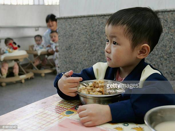 Yue Wenjie a fouryearold HIVinfected Chinese girl has her launch at an orphanage on December 1 2004 in Guangzhou Guangdong Province of China China...