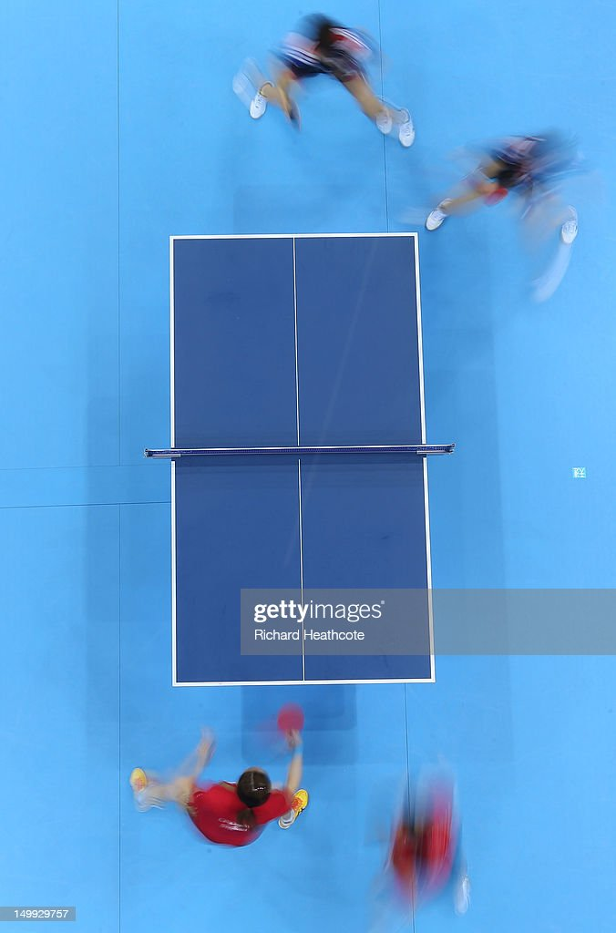 Yuegu Wang and Jiawei Li of Singapore (bottom) compete against Yeseo Dang and Hajung Seok of Korea (top) during the Women's Team Table Tennis bronze medal match on Day 11 of the London 2012 Olympic Games at ExCeL on August 7, 2012 in London, England.
