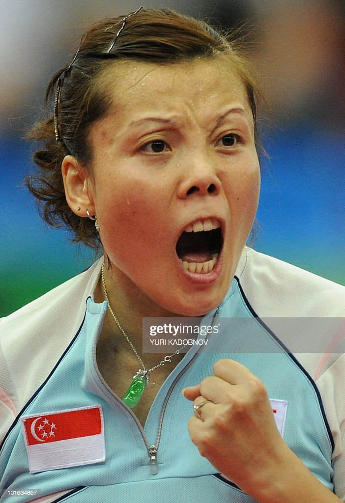 Yuegu Wang of Singapore reacts during the women's semi final against Kristin Silbereisen of Germany at the 2010 World Team Table Tennis Championships in Moscow on May 29, 2010.