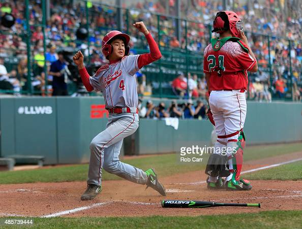 Yugo Aoki of team Japan celebrates after scoring the walk off run to defeat team Mexico 10 during the International Championship game of the Little...