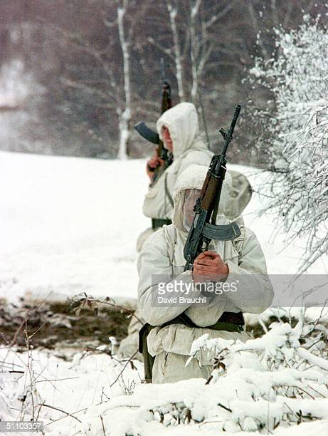 Yugoslav Army Soldiers Wearing A SnowSuits On Look Out Tuesday Feb 23 1999 In Position Behind A SnowCovered Bushes In Bukos Northern Kosovo The Army...