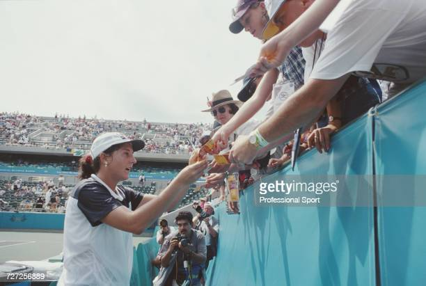 Yugoslavia born American tennis player Monica Seles signs autographs for fans during competition for the United States team to reach the...