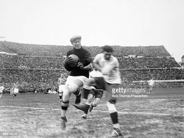 Yugoslavian goalkeeper Milovan Jaksic catches the ball under pressure from Uruguay's Santos Iriarte during the FIFA World Cup SemiFinal at the...