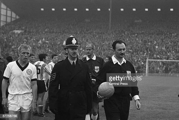 Yugoslavian referee Konstantin Yecevic leaves the pitch at Villa Park with a police escort after the Group B match between Argentina and West Germany...