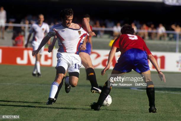 Yugoslavia's Dejan Savicevic has his shirt pulled as he tries to go past Spain's Manuel Sanchis