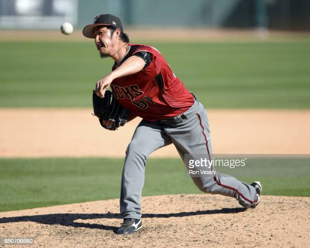 Yuhei Nakaushiro of the Arizona Diamondbacks pitches against the Chicago White Sox during a spring training game on March 01 2017 at Camelback Ranch...