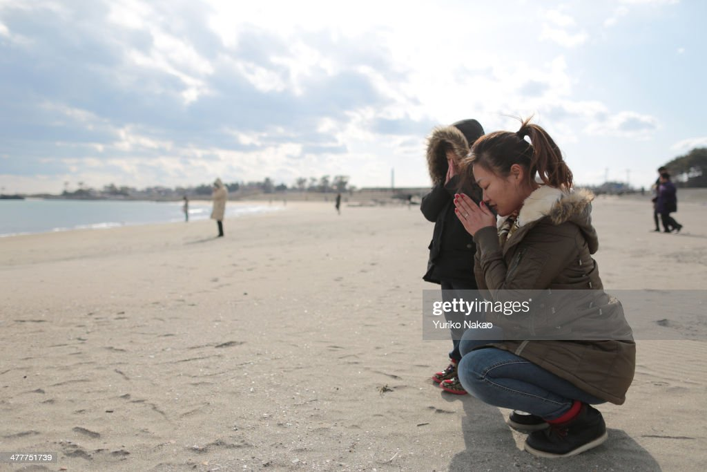 Yui Goto and her son Kotaro fold their hands together as they observe a moment of silence at 2:46 p.m., the time at which the magnitude 9.0 earthquake struck at Shobuta beach on March 11, 2014 in Shichigahama town, Miyagi Prefecture, Japan. On March 11 Japan commemorates the third anniversary of the magnitude 9.0 earthquake and tsunami that claimed more than 18,000 lives, and subsequent nuclear disaster at the Fukushima Daiichi Nuclear Power Plant.