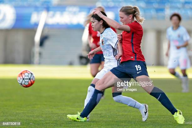 Yui Hasegawa of Japan challenges Ingvild Isaksen of Norway during the match between Norway v Japan Women's Algarve Cup on March 6 2017 in Loule...