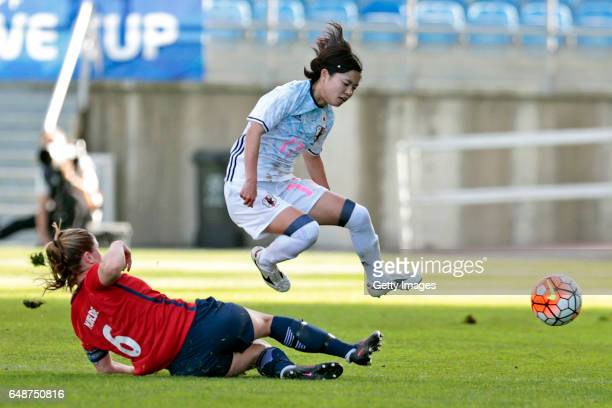 Yui Hasegawa of Japan challenges Maren Mjelde of Norway during the match between Norway v Japan Women's Algarve Cup on March 6 2017 in Loule Portugal