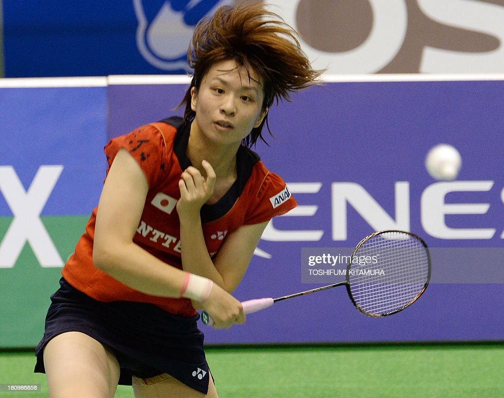 Yui Hashimoto of Japan hits a return during her women s singles