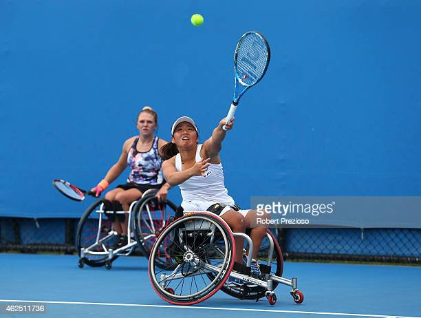 Yui Kamiji of Japan and Jordanne Whiley of Great Britain in action in their women's wheelchair doubles final match against Jiske Griffioen of the...