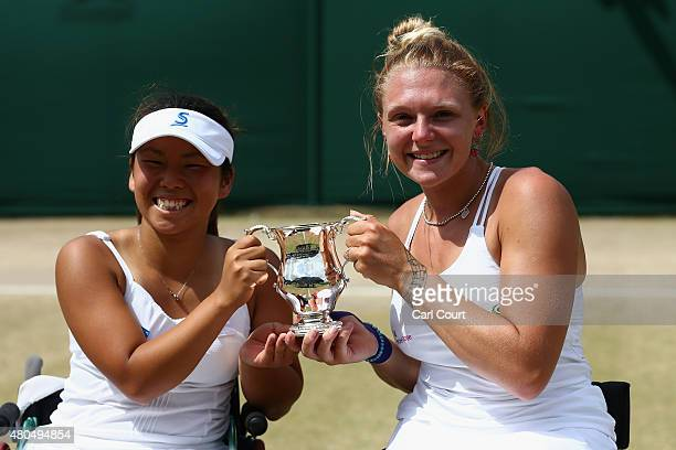 Yui Kamiji of Japan and Jordanne Whiley of Great Britain pose with the trophy after winning the Wheelchair Ladies Doubles Final against Jiske...