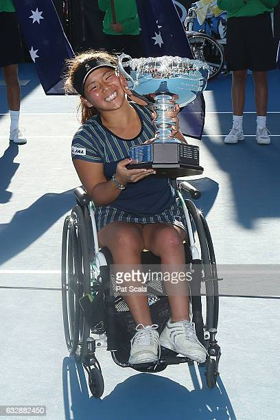 Yui Kamiji of Japan celebrates with the trophy after winning the Women's Wheelchair Singles Final against Jiske Griffioen of the Netherlands during...
